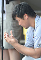 Daisuke Matsuzaka (Clippers),<br /> JUNE 11, 2013 - MLB :<br /> Daisuke Matsuzaka of the Columbus Clippers look at his injured thumb in the dugout during minor's International League (Triple-A) baseball game against the Gwinnett Braves at Coolray Field in Lawrenceville, Georgia, United States. (Photo by AFLO)