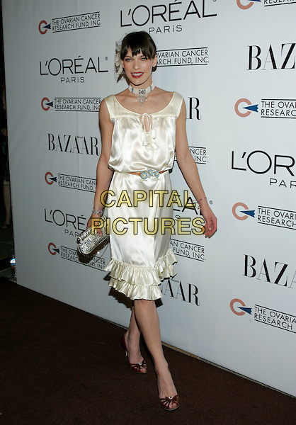 MILLA JOVOVICH.L?Oreal Paris® Presents the ?As Seen In? Harper?s Bazaar? event to benefit the Ovarian Cancer Research Fund held at The Lindbrook Gallery in Westwood, California  .December 8th,2005.Ref: DVS.full length white silk satin dress silver clutch purse.www.capitalpictures.com.sales@capitalpictures.com.Supplied By Capital PIctures