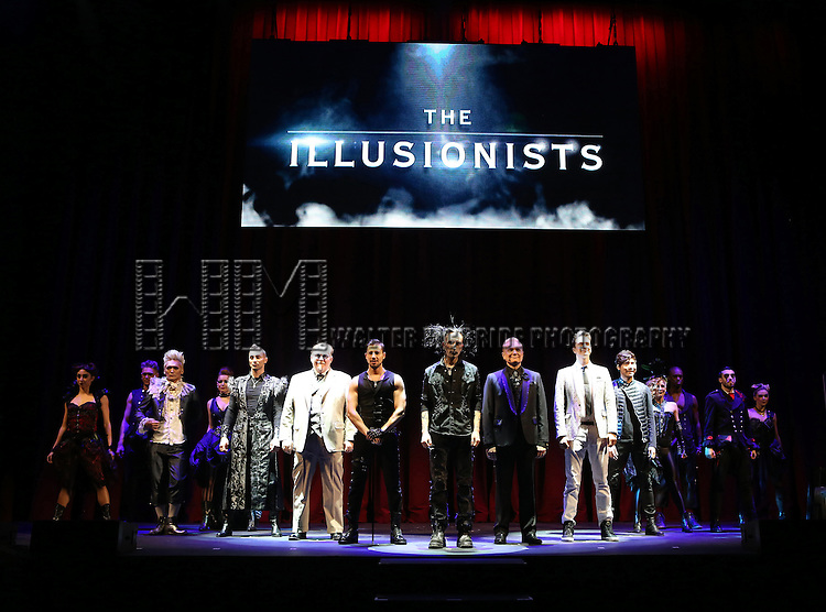 Aaron Crow, Kevin James, Jeff Hobson, Dan Sperry, Andrew Basso, Adam Trent and Yu Ho-Jin with the cast performing in a press preview of 'The Illusionists' at Mariott Marquis Theatre on December 2, 2014 in New York City.