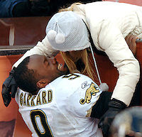 Jacksonville Jaguars quarterback #9 David Garrard wears a big smile as he gets a hug and kiss from his wife Mary Garrard leaning over the railing at Cleveland Browns Stadium after leading the Jags to a come-from-behind victory in Cleveland Ohio. (Rick Wilson/The Florida Times-Union)