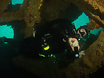Apo Reef, Sulu Sea -- Diver inside Apo Wreck.