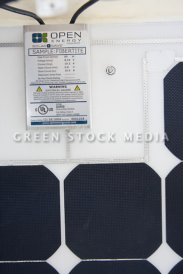 Close-up of a sample of Open Energy Corporation's SolarSave Roofing Membrane solar panel with SunPower solar cells used on the IDeAs building. Contact Green Stock Media to view additional images from this photo shoot. Image size: 4368 x 2912 pixels, very high resolution, 12.8 megapixels