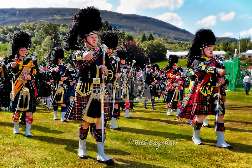 Braemar Gathering drum majors lead the massed pipe bands at Braemar