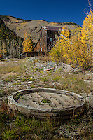 An old mine with Aspens turing bright yellow in the San Juan Mountains near Telluride Colorado.