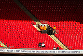 2nd February 2019, Wembley Stadium, London England; EPL Premier League football, Tottenham Hotspur versus Newcastle United; A couple of Tottenham Hotspur fans watch the game from a empty stand