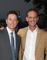 WESTWOOD, CA - AUGUST 9: Mark Wahlberg, Peter Berg, at Premiere Of STX Films' &quot;Mile 22&quot; at The Regency Village Theatre in Westwood, California on August 9, 2018.<br /> CAP/MPIFS<br /> &copy;MPIFS/Capital Pictures