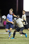 Alex Bangerl (4) of the Columbia Lions battles for the ball with Ema Twumasi (22) of the Wake Forest Demon Deacons during second half action in the second round of the 2017 NCAA Men's Soccer Championship at Spry Soccer Stadium on November 19, 2017 in Winston-Salem, North Carolina.  The Demon Deacons defeated the Lions 1-0.  (Brian Westerholt/Sports On Film)