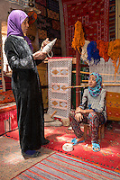 Morocco.  Amazigh Berber Mother and Daughter in Rug Workshop, Ait Benhaddou Ksar, a World Heritage Site.