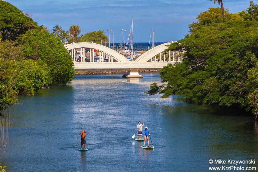 Stand-up Paddleboarders on Anahulu Stream in Haleiwa, North Shore, Oahu, Hawaii