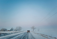 Driving through morning mist and snow during a hunting trip near Grand Island, Nebraska, Sunday, December 4, 2011. Hunting duck and White Tail deer is common in the area...Photo by Matt Nager
