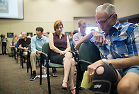 """NWA Democrat-Gazette/CHARLIE KAIJO John Douglas of Bentonville (right) listens to respondents share their opinions about the Confederate statue in Bentonville Square at the Walmart Auditorium in the Shewmaker Center for Workforce Technologies, NWACC Campus in Bentonville, AR on Saturday, September 9, 2017. """"I came to realize there are people who have other opinions and they deserve consideration. I have been on that side that feels strongly about that statue being there,"""" he said. """"I have come to think that I should not be inflexible."""" Community members discussed opinions on the Confederate soldier statue in the Bentonville Square and what should be done about it."""