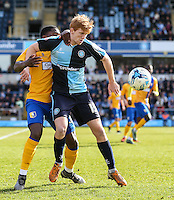 Ryan Sellers of Wycombe Wanderers holds off Mitch Rose of Mansfield Town during the Sky Bet League 2 match between Wycombe Wanderers and Mansfield Town at Adams Park, High Wycombe, England on 25 March 2016. Photo by David Horn.