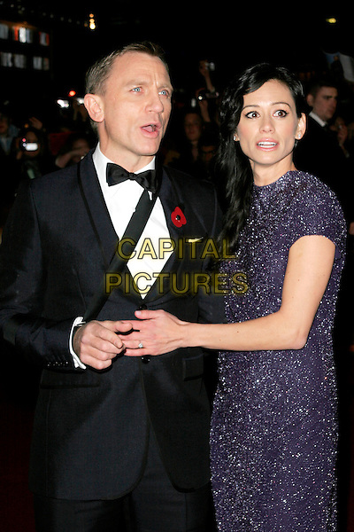 "DANIEL CRAIG & SATSUKI MITCHELL.The Royal World Premiere of ""Quantum Of Solace"" at the Odeon Leicester Square, London, England..October 29th 2008.James Bond half length black tuxedo jacket bow tie purple sparkly dress sling couple .CAP/AH.©Adam Houghton/Capital Pictures."