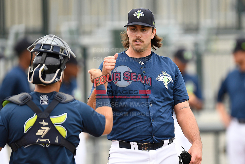 Starting pitcher David Peterson (30) of the Columbia Fireflies bumps fists with catcher Scott Manea before a game against the Greenville Drive on Sunday, May 27, 2018, at Spirit Communications Park in Columbia, South Carolina. Greenville won, 3-0. (Tom Priddy/Four Seam Images)