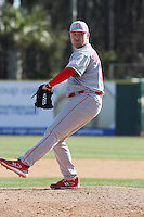 Jake Buchanan of the North Carolina State Wolfpack pitching in a game against  the Coastal Carolina University Chanticleers at the Baseball at the Beach Tournament held at BB&T Coastal Field in Myrtle Beach, SC on February 28, 2010.