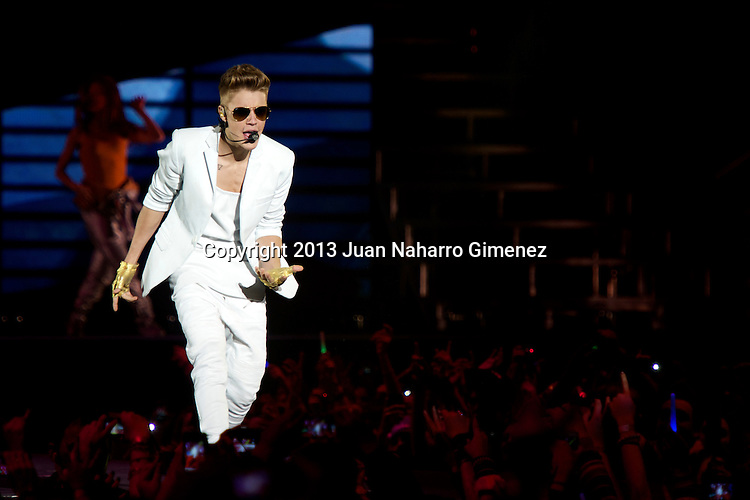 MADRID, SPAIN - MARCH 14:  Justin Bieber performs on stage at the Palacio de los Deportes stadium on March 14, 2013 in Madrid, Spain.  (Photo by Juan Naharro Gimenez)
