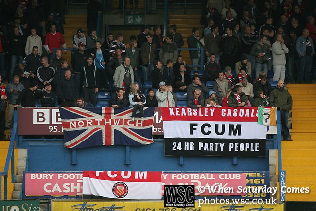 FC United of Manchester 8, Glossop North End 0, 28/10/2006. Gigg Lane, Bury, North West Counties League division one. Fans watching from the stands as FC United of Manchester take on Glossop North End (blue shirts) in a North West Counties division one match at United's home stadium, Gigg Lane, home to Bury FC. The match was staged on People United Day, an event started in 1999 which brought together fans from across Europe to campaign against racism. FC United were formed in the summer of 2005 by supporters of Manchester United in response to the take over of their club by American millionaire Malcolm Glazer and his family. The club entered the football pyramid at the lowest level with the intention to climbing through the leagues. FCUM won the match 8-0, watched by 3257 spectators. Photo by Colin McPherson.