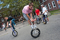 Governor's  Island, NY -  4 September 2010 Jason Katz, left, and Jim Riley, center, complete on the freestyle event during the New York City Unicycle Festival on Governor's Island.