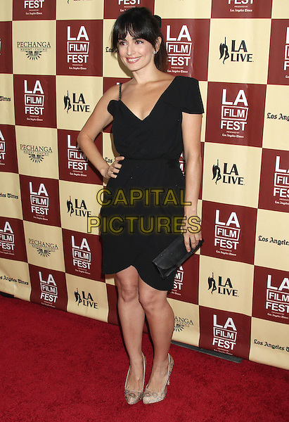 "Ana de la Reguera.Los Angeles Premiere of Summit Entertainment ""A Better Life"" held at Regal Cinemas L.A., Los Angeles, California, USA..June 21st, 2011.full length black dress clutch bag beige snakeskin animal print shoes hand on hip.CAP/ADM/RE.©Russ Elliot/AdMedia/Capital Pictures."