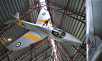 BNPS.co.uk (01202 558833)<br /> Pic: RAFMuseumCosford/BNPS<br /> <br /> RAF Hawker Hunter trainer.<br /> <br /> Prop Dusting - The annual spring clean of the stunning aircraft hall at the RAF Museum at Cosford has begun.<br /> <br /> A crack team of aerial cleaners are abseiling over the historic aircraft, some of which are suspended up to a hundred feet above the museum floor, all week to clean away any residue dust and check over the suspension cables.