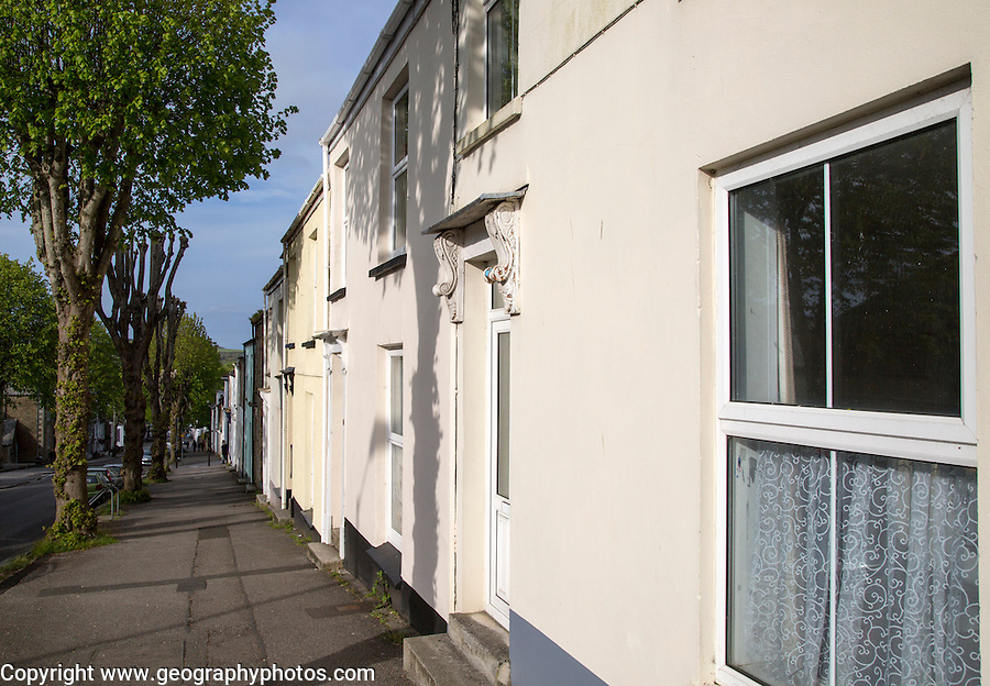 Row of terraced houses opening onto the pavement, Killigrew Street, Falmouth, Cornwall, England, UK