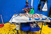A Panamanian fisherman cleans the fish at Mercado de Mariscos seafood and fish market in Panama City, Panama, 1 February 2015.