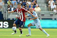 Chivas USA forward Justin Braun (17) holds off the challenge from Sporting KC defender Aurelien Collin... Sporting KC and Chivas USA played to a 1-1 tie at LIVESTRONG Sporting Park, Kansas City, Kansas.