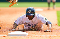 Alejandro De Aza #7 of the Charlotte Knights slides head first into third base during an exhibition game against the Kannapolis Intimidators at Knights Stadium on April 3, 2011 in Fort Mill, South Carolina.    Photo by Brian Westerholt / Four Seam Images