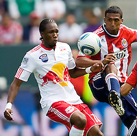 Chivas USA defender Dario Delgado (12) battles with NY RedBulls forward Macoumba Kandji (10). NY RedBulls midfielder Joel Lindpere (20)psychs up his teammates. Chivas USA defeated the Red Bulls of New York 2-0 at Home Depot Center stadium in Carson, California April 10, 2010.  .