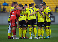 The Phoenix huddle before the A-League football match between Wellington Phoenix and Perth Glory at Westpac Stadium in Wellington, New Zealand on Sunday, 27 October 2019. Photo: Dave Lintott / lintottphoto.co.nz