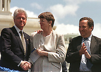 United States President Bill Clinton, left, shakes hands with US Attorney General Janet Reno, center, as US Secretary of the Treasury Lawrence Summers, right, looks on at the 19th annual Fraternal Order of Police Peace Officers Memorial in front of the US Capitol in Washington on May 15, 2000. <br /> Credit: Ron Sachs / CNP /MediaPunch