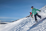 USA, California, Mammoth, a skier and boarder enjoying the fresh powder turns at Mammoth Ski Resort