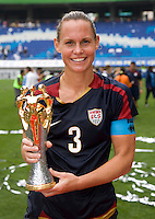 USWNT captain Christie Rampone holds the tournament trophy after the finals of the Peace Queen Cup.  The USWNT defeated Canada, 1-0, at Suwon World Cup Stadium in Suwon, South Korea.