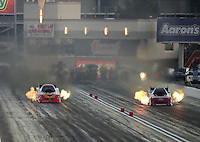 Oct. 27, 2012; Las Vegas, NV, USA: NHRA funny car driver Bob Tasca III (right) races alongside Jim Head during qualifying for the Big O Tires Nationals at The Strip in Las Vegas. Mandatory Credit: Mark J. Rebilas-