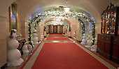 """The 2016 White House Christmas decorations are previewed for the press at the White House in Washington, DC on Tuesday, November 29, 2016. Pictured are the decorations in the Lower Cross Hall / Ground Floor Corridor.  The first lady's office released the following statement to describe those decorations, """"This year's holiday theme, 'The Gift of the Holidays,' reflects on not only the joy of giving and receiving, but also the true gifts of life, such as service, friends and family, education, and good health, as we celebrate the holiday season.""""<br /> Credit: Ron Sachs / CNP"""