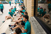"Members eat lunch during ""Circle the City with Service,"" the Kiwanis Circle K International's 2015 Large Scale Service Project, on Wednesday, June 24, 2015, in Indianapolis. (Photo by James Brosher)"