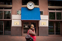 A woman walks by a Connecticut Bank and Trust Company branch in Hartford, Connecticut, Saturday August 6, 2011. Connecticut Bank and Trust Company is a small bank doing business in Connecticut.