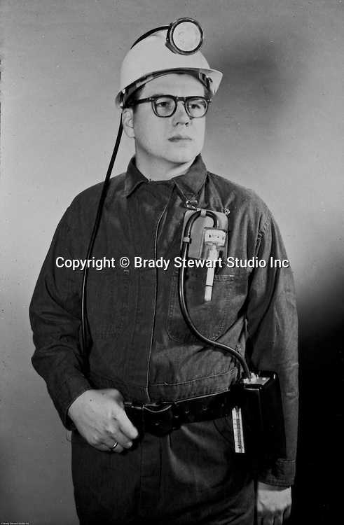 Pittsburgh PA - View of a coal miner wearing a miner's hat and oxygen detector - 1970. Studio assignment from WF Minnick and Associates advertising