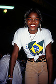 Bahia, Brazil. Smiling Brazilian mulatta girl in a Brazil flag t-shirt.