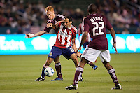 Newly acquired CD Chivas USA midfielder Nick LaBrocca (10) is marked by Colorado Rapids midfielder Jeff Larentowicz (4). The Colorado Rapids defeated CD Chivas USA 1-0 at Home Depot Center stadium in Carson, California on Saturday March 26, 2011...
