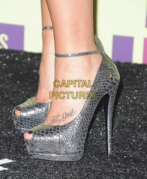 Demi Lovato's shoes.2012 MTV Video Music Awards held at Staples Center, Los Angeles, California, USA..September 6th, 2012.feet heels detail silver ankle strap let god snakeskin metallic       .CAP/DVS.©DVS/Capital Pictures.