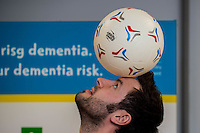 Friday 10 February 2017<br /> Pictured: Events manager Ian Robson palaces a ball on his head <br /> Re:Welsh Government Dementia Risk Prevention Roadshow at the BT building, Swansea, Wales, UK