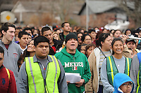 NWA Media/ANDY SHUPE - Parishioners part in the ninth-annual pilgrimage walk to celebrate The Feast of Our Lady of Guadalupe Sunday, Dec. 14, 2014, in Fayetteville. Parishioners walked from St. Joseph Catholic Church in Fayetteville to St. Raphael Church in Springdale. Visit nwamedia.photoshelter.com to see more photos from the event.