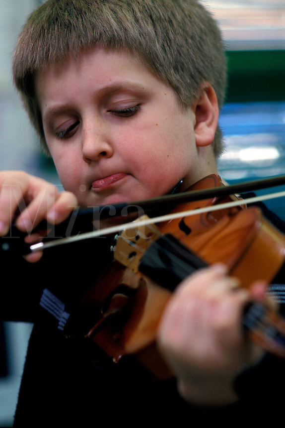 Boy playing the violin. music, child, children, education, school,