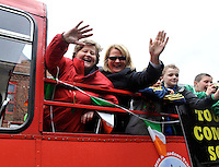 17-3-2014: Kathleen and Ann Mangan wave to the crowd during the St. Patrick's Day Parade in Killarney County Kerry on Monday.<br /> Picture by Don MacMonagle