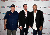 Aug. 29, 2013; Avon, IN, USA: NHRA NHRA former driver Tom McEwen (left) with actor Richard Blake (center) and racer  Don Prudhomme on the red carpet prior to the premiere of Snake & Mongoo$e at the Regal Shiloh Crossing Stadium 18. Mandatory Credit: Mark J. Rebilas-