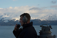 130430-N-DR144-474 COOK INLET, Alaska (April 30, 2013)- Quartermaster Seaman Garrett Smith stands watch as a starboard lookout aboard San Antonio-class amphibious transport dock ship USS Anchorage (LPD 23) as the ship approaches the coast of Alaska. Anchorage is currently en route to its namesake city of Anchorage, Alaska for its commissioning ceremony May 4. (U.S. Navy photo by Mass Communication Specialist 1st Class James R. Evans / RELEASED)