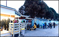 BNPS.co.uk (01202 558833)<br /> Pic: RogerArbon/BNPS<br /> <br /> The queue at 7am this morning (Monday), for the beach huts.<br /> <br /> A group of hardy souls combined two great British traditions to queue out overnight to secure a sought-after beach hut for the summer.
