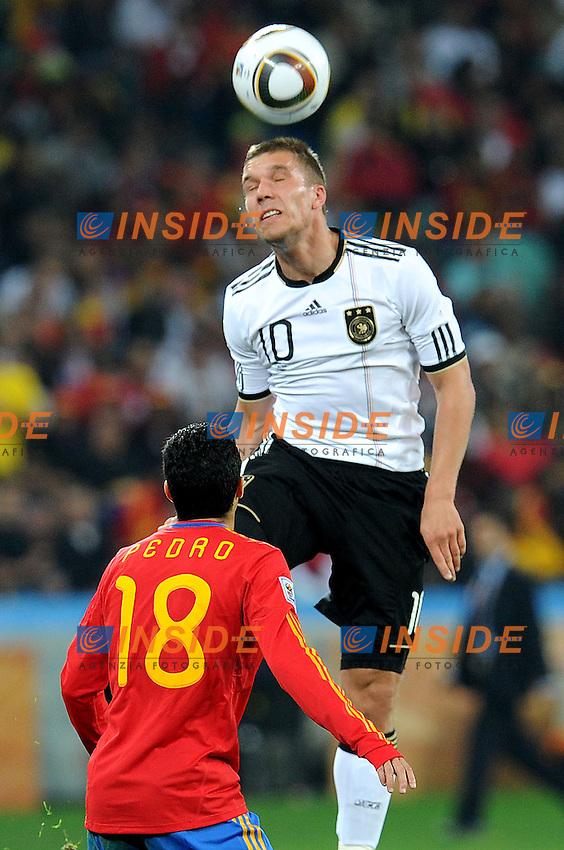 Lukas Podolski (Germania) e Pedro (Spagna)<br /> Germania Spagna - Germany vs Spain<br /> Semifinale - Semifinal<br /> Campionati del Mondo di Calcio Sudafrica 2010 - World Cup South Africa 2010<br /> Moses Mabhida Stadium, Durban 07/07/2010<br /> &copy; Giorgio Perottino / Insidefoto