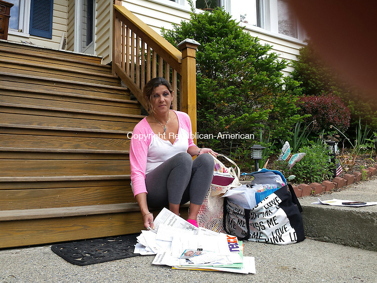 TORRINGTON, CT- 30 May 2014- 053014BJ02-- Widow Beth Profeta sits on the front steps of her New Harwinton Road in Torrington on Friday. Profeta has been trying to modify the terms of her mortgage with no success. Bruno Matarazzo Jr. Republican-American